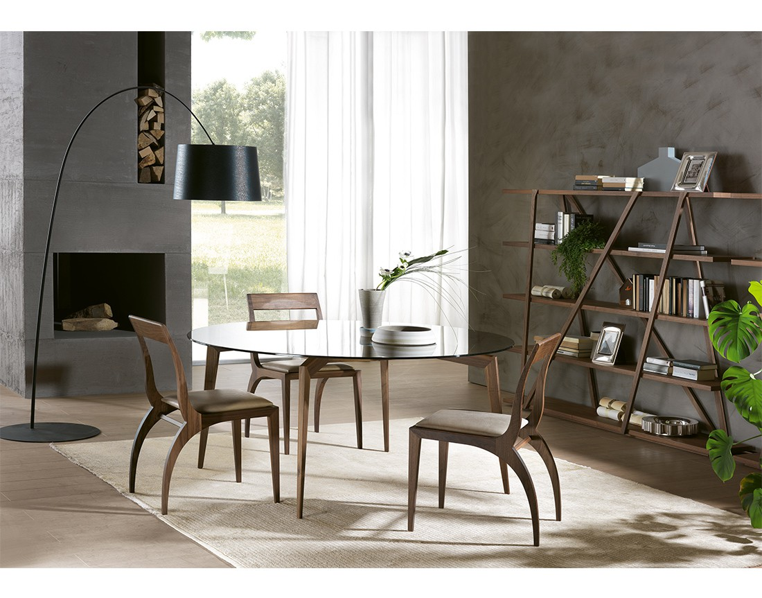 Hope: tavolo da pranzo rotondo piano vetro, Made in Italy in ambiente moderno | Hope: round glass top dining table, Made in Italy, in a modern living
